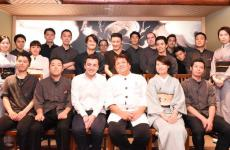 Third from the left, front line, Michele Biassoni, chef at Iyo in Milan, with the team from Ryugin in Tokyo, 3 Michelin stars, where he attended a 3-month internship, from August to November 2017. ChefSeiji Yamamoto is standing beside him