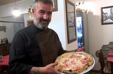 Massimo Bosco and his pizza with fiordilatte, peretta di Berchidda (a local cheese), rolled pancetta and shaved GranAnglona