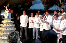 Enrico Cerea on stage with the cake for Da Vittorio's 50th anniversary. The celebration also offered a chance to present Ea(s)t Lombardy, with the area becoming the 2017 European Region of Gastronomy